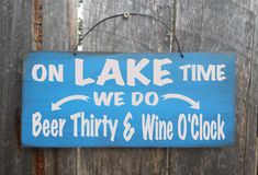 On Lake Time We Do Beer Thirty and Wine OClock sign is hand painted on 8x18 outdoor grade plywood and finished with our signature