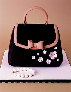 Adorable bag cake - Visit http://www.craftcompany.co.uk/ for all your cake decorating products.