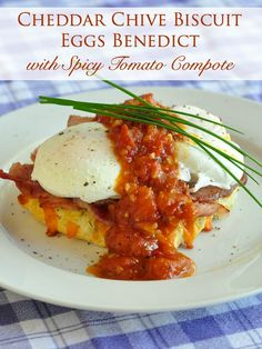 Cheddar Chive Biscuit Eggs Benedict - a lighter version of this classic breakfast featuring a low fat quick cooked tomato compote instead of Hollandaise sauce.