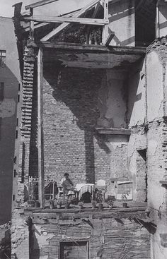 A MAKESHIFT BALCONY BERLIN CHARLOTTENBURG, 1945 … after the war, about 2/3 of all buildings in west berlin have been either destroyed or damaged. … sad and beautiful.