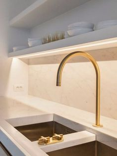 gold tone hardware by dornbracht --- #dornbracht #faucet #interiordesign #design