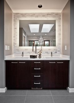 Gray tile floor with espresso color cabinet. Too dark? Like the tiled wall around the mirror.