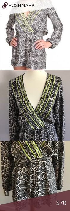 Dolce Vita snake print long sleeve romper Like brand new. This romper has the most amazing details. Faux wrap front. Keyhole back with hook at neck and then drapes and is open at small of back. Snake print gets darker at end of sleeves, neons green piping detail. Perfect for date night or ladies night. 100% polyester. Dolce Vita Pants Jumpsuits & Rompers
