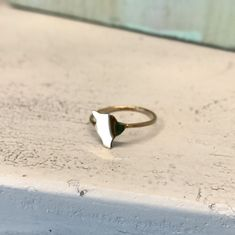 A personal favorite from my Etsy shop https://www.etsy.com/listing/599888968/big-island-of-hawaii-dainty-ring-made-to