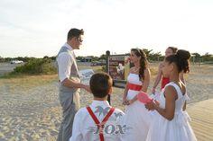 Ocean City Wedding Minister Sean Rox during a rehearsal with beach bride at the Assateague Island State Park  before a beautiful sunset beach wedding ceremony:  https://www.roxbeachweddings.com/