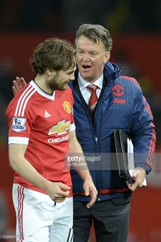 Manchester United's Dutch manager Louis van Gaal (R) talks with Manchester United's Dutch midfielder Daley Blind (L) at the end of the English Premier League football match between Manchester United and Watford at Old Trafford in Manchester in north west England on March 2, 2016. / AFP / OLI SCARFF / RESTRICTED TO EDITORIAL USE. No use with unauthorized audio, video, data, fixture lists, club/league logos or 'live' services. Online in-match use limited to 75 images, no video emulation. No…