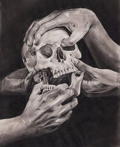 The hands hold the skull art.
