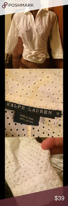 "💐Ralph Lauren BLACK LABEL💯cotton eyelet wrap top Timeless & totally chic! Very good pre owned condition  Ralph Lauren black label 💯cotton white eyelet top. 3/4"" sleeves, unlined, lightweight but very well made! Layer over cami, thirst, or dress up your Spring summer outfits! A few discoloration so on inside neck, but not noticeable when wearing!No rips, or tears. Just needs a good steaming! You will wear this forever!💐 Ralph Lauren Black Label Tops"