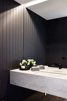 The black panelling would accent the dark veining in our #Cambria #PraaSands [original: Lubelso Hawthorn]