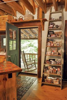 (1100 sq ft)  Not so little, hand-built home. Affordable. Green. In Wedowee, Ala., Guy and Kay Baker live in a cozy cabin they built with their three sons using almost entirely reclaimed materials.  Read more: http://www.motherearthnews.com/green-homes/reclaimed-materials-sustainable-home-zm0z11zphe.aspx#ixzz2WVw67eom