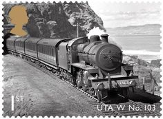 Stamp from the Classic Locomotives of Northern Ireland issue, released 18th June 2013 by Royal Mail. 1st Class – UTA Class W No.103. 'Thomas Somerset' with a Belfast-bound up express between the two tunnels at Downhill, west of Castlerock c1950.