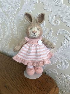 Say hello to this gorgeous bunny! She is hand knitted using beautiful baby alpaca wool. Her pretty little dress is made from 100% cotton and is removable. Her shoes can not be removed. She is made using all new materials and is stuffed with crest-a-Lon fibre filling. This bunny is