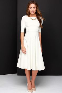 This is perfect! This is totally perfect for a getaway dress! // Having a Shindig Ivory Midi Dress at Lulus.com!