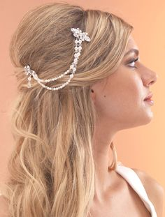 """This vintage style bridal hair drape measure just 6"""" long and it's hand strung double pearl & crystal strand design is unusual but elegant. Great if you want to make a subtle statement with your bridal accessories."""
