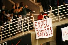 Two MSU basketball players raped a woman in the dorms then one admitted to it. Their only consequence was that they had to move out of the dorms. These two protesters displayed this banner during March Madness. This was taken before we got booed at by 10,000 people and police escorted from the stadium. <------What kind of asshole boos somebody protesting rape??? Oh yea, that's right. When the rapist is a famous athlete. PROTECT THE ATHLETE!!!! SHAME THE VICTIM!!!!