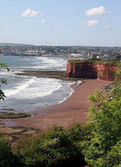 Paignton in Devon, red sand, went there when I was 4.