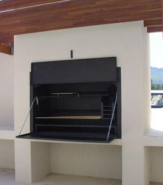 The Braai is a versatile outdoor, wood burning barbecue, come oven. It is a beautifully elegant and stylish design feature for any outdoor entertaining/ dining area and forms a social hub at parties and gatherings with family and friends. Built In Braai, Built In Grill, Outdoor Kitchen Design, Patio Design, Parrilla Interior, Barbecue Area, Built Ins, Decoration, Elegant