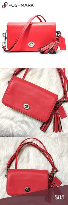 Coach Legacy Penny Leather Crossbody Bag Pre-loved in like new condition, was only carried a couple of times. This Coach Legacy Penny Leather Crossbody Bag comes in a gorgeous Red Orange Coral color! Love the tassel accessories on the side. Has its original hangtag. Interior lining is tan. Main compartment has 1 slide in pocket. There is also an additional front side in pocket. Love the silver hardware turnlock. Coach logo in silver on the back. Remove the strap & it becomes a clutch…
