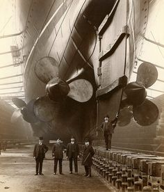 """John Currie - Mauretania    This photograph is taken in Canada Dock in Liverpool, 1909. The gentleman in uniform is """"Mauretania's"""" first Chief Engineer, John Currie.    RMS MAURETANIA was one of the most famous ships ever built on Tyneside    Reference: TWAS: DS.WS/143/68"""