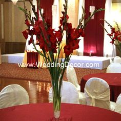 Wedding Centerpiece - red gladiolus and white crushed glass in a pilsner vase