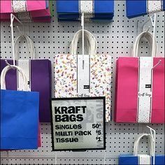 The rise-over-run of these Diagonal-Braced Drop-Arm Hooks for Gift Bags provided significant visibility and accessibility to the rearmost merchandise. Kraft Bag, Gift Bags, Hooks, Waterfall, Arms, Retail, Gift Wrapping, Sign, Pattern