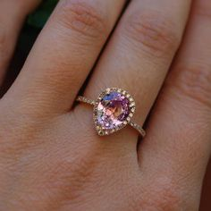 Love this teardrop pink sapphire engagement ring