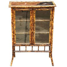 English Bamboo Bookcase | From a unique collection of antique and modern bookcases at http://www.1stdibs.com/furniture/storage-case-pieces/bookcases/