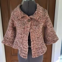 """FREE PEOPLE Wool-blend Crochet Shrug FREE PEOPLE Wool-blend Crochet Shrug.   3/4 bell sleeves.  Pink, brown, beige & gold metallic variegated wool/nylon/poly/acrylic/other blend fiber.  Shoulder width 15"""".  Length 16"""".  Great condition.  Note:  size tag removed, see measurements. Free People Sweaters Shrugs & Ponchos"""