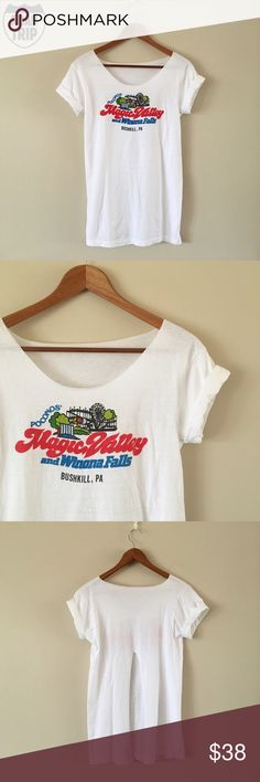 Pocono's Magic Valley Vintage Tee Crisp white tee from Pocono's Magic Valley in Bushkill, PA. Defunct amusement park that opened in 1977 and closed in 1982. Neck is cut, slit up back, rolled sleeves. Reminds me of the Bob-Lo tee seen on Madonna in the 80s, another defunct amusement park that shut down in 1993.  BRAND: - MATERIAL: 100% cotton YEAR/ERA: 70s LABEL SIZE: M BEST FIT: S  MEASUREMENTS: Chest 17 inches Length 28 inches   Trades  Modeling  Check out my closet for more vintage…