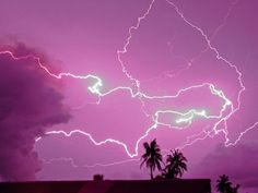 Volcano-Cloud Lightning Photograph by Steve and Donna O'Meara, National Geographic  Volcanic lightning is rare, and lightning between thunderstorms and ash clouds even more so. In this photo, taken in May 2009, lightning flashes between a thunderstorm and the eruption plume from Rabaul volcano on New Britain Island in Papua New Guinea.