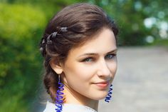 two versions of braids called crown braids – these heidi braids and these French braided crowns.  With ribbon - messy days