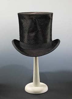 Top Hat 1875 I think you should have all you guest wear top hats to a black and white 50th Birthday party. It would be fun.