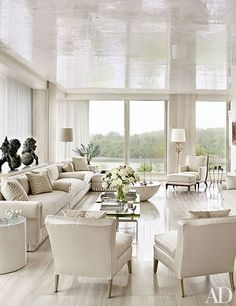 The all-white living room features a gleaming travertine floor and walls and a waxed Venetian-plaster ceiling | archdigest.com