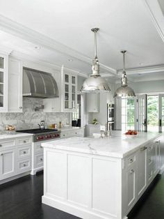 Seven Inspiring White Kitchens - Carrera marble in this one!