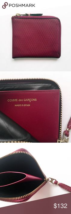 """COMME DES GARCONS CDG wine half zip leather wallet COMME DES GARCONS  made in Spain.  minimalist. ultra slim, compact. unisex.  half zip closure. space for notes,  center for cards/coins. textured leather, brass hardware.  RARE, sold out. $250, Barneys NY boston.  clean, minimal use. pet/smoke free.  length: 4.5"""" height: 4""""  no dust bag box limited edition exclusive maroon red burgundy wine luxury goods men women accessory accessories Comme des Garcons Bags Wallets"""