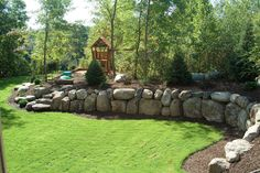 Boulder retaining wall, bark mulch for playground, conifers for landscaping   http://www.houzz.com/photos/590809/Boulder-Retaining-Wall-traditional-landscape-minneapolis
