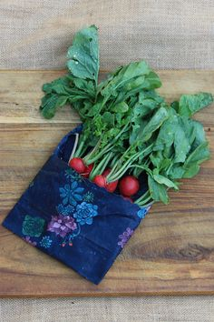 Large #beeswaxwrap #Apiwrap from our Journey collection wrapped like a pocket to fit nicely all the radishes.