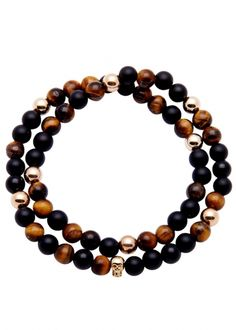 Hand-finished Nialaya tiger eye and matte onyx beaded wrap bracelet 14kt gold skull embellishment and beads Presented in a designer-stamped pouch