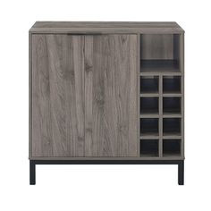 This modern bar cabinet is the perfect addition to your home for some added storage and style. Features an 8-bottle wine storage and open storage cubby as well as three rows of glass hangers and an interior shelf. Durably constructed of high-grade MDF and powder-coated metal, this beautifully designed piece will become a staple in your kitchen. Cabinet Furniture, Bar Furniture, Furniture Deals, Sideboard Cabinet, Cubby Storage, Wine Storage, Mid Century Modern Buffet, Modern Bar Cabinet, Wine Cabinets