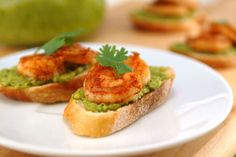 spicy shrimp and avocado crostini! you canmake it as spicy as you'd like (chili powder rub) and the avocado spread is less fattening when made with chick peas instead of sour cream!all on a french baguette Spicy Shrimp Recipes, Shrimp Appetizers, Fish Recipes, Appetizer Recipes, Healthy Recipes, Avocado Spread, Favorite Recipes, Crostini Recipe, Shrimp Avocado