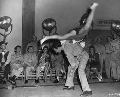 Dance Spin: An American serviceman throws his jitterbug dance partner over his back, 1943 (Keystone Features/Getty Images)