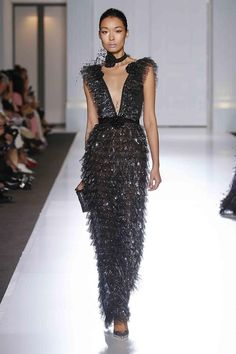 Black tulle ruffle gown with silver sequin hotfix and crystal encrusted floral brooches.