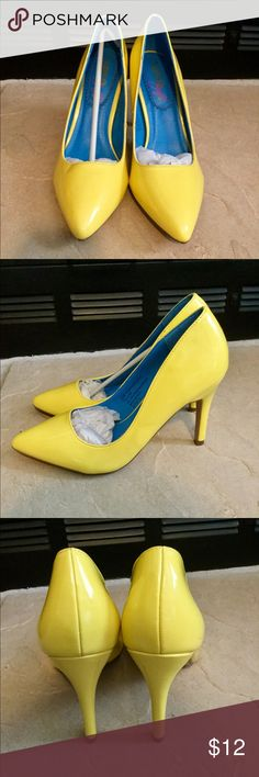 Brand new ladies yellow dress heels!!! Brand new yellow heels. They have a 4 in. heel. There are some indentions on the shoes as shown in pics above. XOXO Soft Shoes Heels