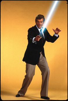 Even if Roger Moore isn't your favorite James Bond, he clearly looks the best with a lightsaber. Sure, we don't actually know what Daniel Craig looks like with a lightsaber, but Moore h… Roger Moore, James Bond, Chewbacca, Eric Rogers, Jedi Knight, The Force Is Strong, Sean Connery, Luke Skywalker, E Bay