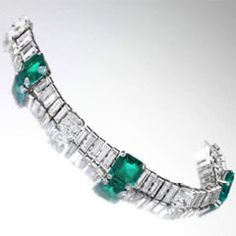 This diamond and emerald bracelet is circa 1935.