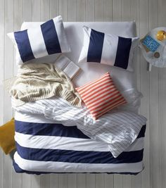 Nautical Bed sheets, blue, white, coral, tan. I have a slight nautical obsession that X is getting use to lol