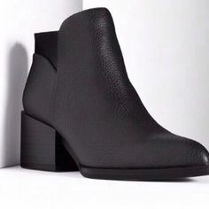 Comfy & Cozy Black Booties These super cute booties have a 2.25 heel. They have a pointed toe for your latest style. Zips in the back for easy on and off! Dress them up or dress them down, you can't go wrong with these! Simply Vera Vera Wang Shoes Ankle Boots & Booties