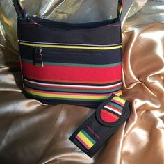"""Cute Purse & Cell Case Just like new,  looks like never used.  Nice vivid colors, clean inside and out.  18"""" drop from top strap to bottom of bag.  10"""" wide.  These colors pop and will look fun with any look you create. Bags"""