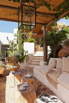 Outdoor living room, wood, trees, couch, blanket, chairs