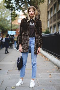 30 Brilliant Street Style Moments From 2016 #refinery29 http://www.refinery29.com/2016/12/133987/best-street-style-2016#slide-19 Veronika Heilbrunner does dressed-down chic in ankle-grazing light-wash jeans, a tee, a leopard-print coat, and a fluffy bag. A+ for effort(lessness)....
